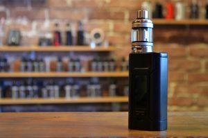 Electronic cigarette on a background of vape shop.
